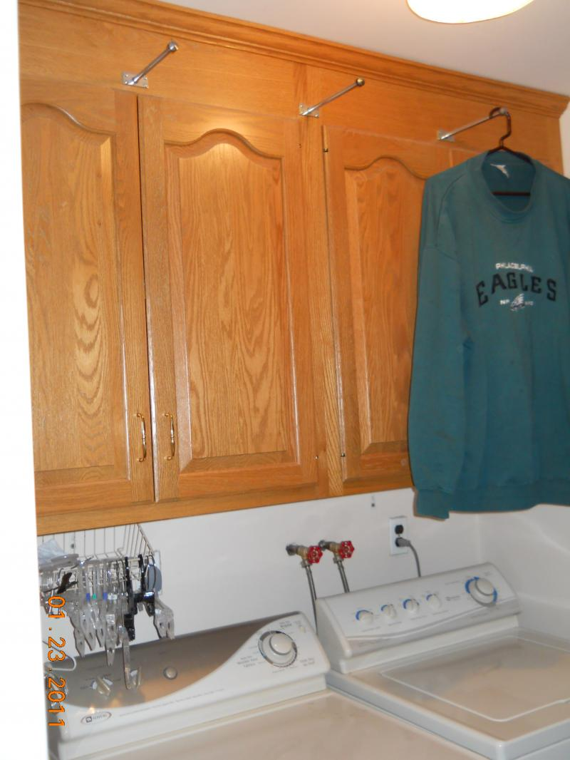 Laundry room cabinets to hold towels, linens, laundry & cleaning products.